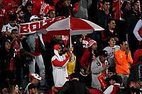 BOGOTA-COLOMBIA, 03–03-2020: Hinchas de Independiente Santa Fe, animan a su equipo durante partido entre Millonarios y el Independiente Santa Fe de la fecha 7 por la Liga BetPlay DIMAYOR 2020 jugado en el estadio Nemesio Camacho El Campin de la ciudad de Bogota. / Fans of Independiente Santa Fe, cheer for their team during a match between Millonarios and Independiente Santa Fe of the 7th date for the BetPlay DIMAYOR Leguaje I 2020 played at the Nemesio Camacho El Campin Stadium in Bogota city. / Photo: VizzorImage / Luis Ramirez / Staff.