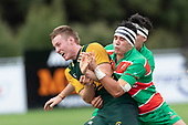 Josh Baverstock gets the ball away as he is hit in a tackle by Christian Walker. Counties Manukau Premier Club rugby game between Pukekohe and Waiuku, played at Colin Lawrie Fields, Pukekohe on Saturday April 14th, 2018. Pukekohe won the game 35 - 19 after leading 9 - 7 at halftime.<br /> Pukekohe Mitre 10 Mega -Joshua Baverstock, Sione Fifita 3 tries, Cody White 3 conversions, Cody White 3 penalties.<br /> Waiuku Brian James Contracting - Lemeki Tulele, Nathan Millar, Tevta Halafihi tries,  Christian Walker 2 conversions.<br /> Photo by Richard Spranger