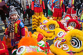 London, UK. 14 February 2016. Duo Duo, 4 years, checks out the costumes of the Lion Dancers. Londoners and the Chinese Community celebrate the Year of the Monkey (Monkey King) with a traditional colourful parade.