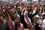 Egyptians take part in a rally after prayer at Tahrir Square in Cairo, Egypt, on July 1, 2011. Hundreds of people were rallying in the square, that was the epicenter of the uprising that toppled Hosni Mubarak, demanding speedy trials for former regime figures and policemen accused of killing protesters during the 18-day revolt earlier this year. The rally is dubbed 'Friday of Retribution' to reflect what protesters perceive as a slow pace of trials of former officials, nearly five months after Mubarak's Feb. 11 ouster. Photo by Ahmed Asad