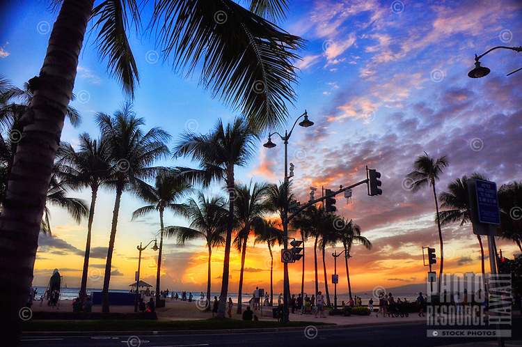 Sunset draws people's attention at Queen's Beach along Kalakaua Avenue in Waikiki, Honolulu, O'ahu.