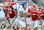 SIOUX FALLS, SD - SEPTEMBER 7:  Luke Fritsch #10 from O'Gorman looks for running room past Reid West #42 from Lincoln in the second quarter of their game at the 2013 Presidents Bowl at Howard Wood Field. (Photo by Dave Eggen/Inertia)