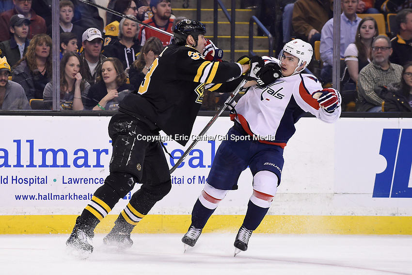 Saturday, March 5, 2016: Boston Bruins defenseman Zdeno Chara (33) checks Washington Capitals defenseman Dmitry Orlov (9) during the National Hockey League game between the Washington Capitals and the Boston Bruins, held at TD Garden, in Boston, Massachusetts. Eric Canha/CSM