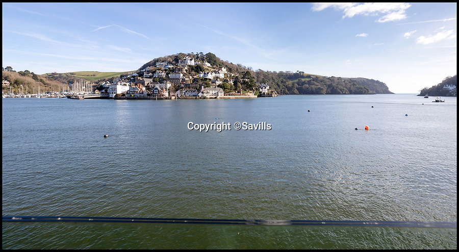 BNPS.co.uk (01202 558833)<br /> Pic: Savills/BNPS<br /> <br /> Stunning views...<br /> <br /> An award-winning waterfront home that has spectacular seaside views has gone on the market for £5m.<br /> <br /> The aptly named River House sits right on the Dart Estuary in Devon and has been so cleverly designed there is a glass floor in the master bedroom that looks down on the water.<br /> <br /> Its main living areas have floor-to-ceiling bi-fold doors and glass Juliet balconies to give the property a feel of Venice rather than Devon.<br /> <br /> Interestingly, the five bedroom house is being sold along with a nearby two bedroom town house that is owned by the same vendors.