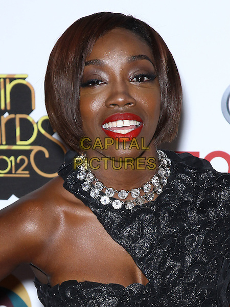 Estelle (Estelle Fanta Swaray).2012 Soul Train Awards red carpet at the fabulous Planet Hollywood Resort and Casino, Las Vegas, Nevada, USA, .8th November 2012..portrait headshot one sleeve shoulder dress black bag collar red lipstick make-up .CAP/ADM/MJT.© MJT/AdMedia/Capital Pictures.