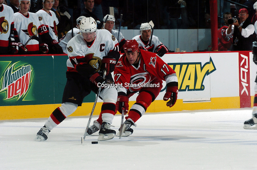 Ottawa Senators captain Daniel Alfredsson (11) of Sweden tries to elude the Carolina Hurricanes' captain Rod Brind'Amour (17) during their game Monday, Oct. 24, 2005 in Raleigh, NC. Carolina won3-2.
