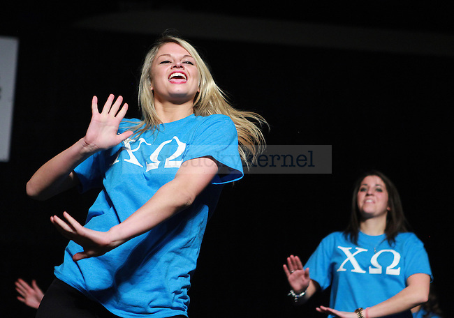 Members of Chi Omega perform at Greek Sing in Memorial Colosseum in Lexington, Ky., on Saturday February 8, 2014. Photo by Emily Wuetcher | Staff
