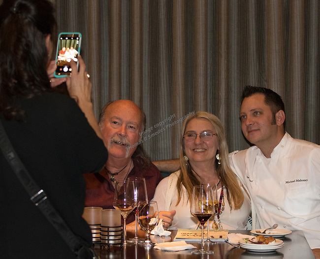 Chef Michael Mahoney, right, poses with guests during a cooking demonstration inside Charlie Palmer Lounge in the Grand Sierra Resort on Thursday night, October 12, 2017.