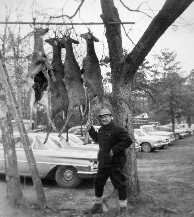 Rep. Silvio Ottavio Conte, R- Mass., House of Representatives Member showing off four young bucks bagged by his party during a hunting trip. 1966 (Photo by CQ Roll Call)