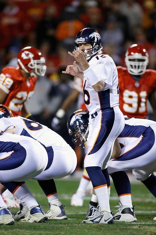 Denver Broncos QB Jake Plummer gives a hand signal in the first quarter at Arrowhead Stadium in Kansas City, Missouri on November 23, 2006. The Chiefs won 19-10.