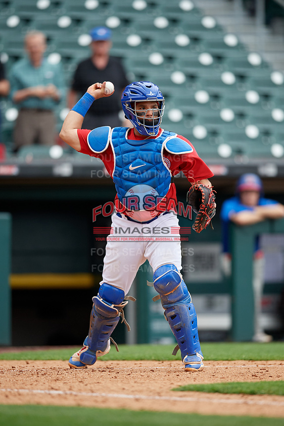 Buffalo Bisons catcher Michael De La Cruz (55) throws to first base during an International League game against the Indianapolis Indians on June 20, 2019 at Sahlen Field in Buffalo, New York.  Buffalo defeated Indianapolis 11-8  (Mike Janes/Four Seam Images)