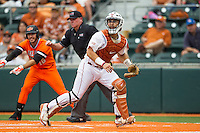 Texas Longhorns catcher Tres Barrera #1 leaves home plate to catch a throw during the NCAA baseball game against the Oklahoma State Cowboys on April 26, 2014 at UFCU Disch–Falk Field in Austin, Texas. The Cowboys defeated the Longhorns 2-1. (Andrew Woolley/Four Seam Images)