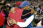 Indianapolis Colts head coach Tony Dungy embraces Dennis Green after a game against the Arizona Cardinals at the RCA Dome in Indianapolis, IN on January 1, 2006. The Colts won 17-13.