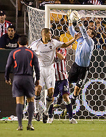 Chivas USA goalkeeper Lance Parker attempts to make a save off a Omar Gonzalez of the LA Galaxy head shot. The LA Galaxy defeated Chivas USA 1-0 to win the final edition of the 2009 SuperClásico at Home Depot Center stadium in Carson, California on Saturday, August 29, 2009...