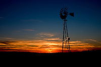 A windmill during sunset on the Cimarron National Grassland in Western Kansas.