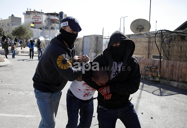 Undercover Israeli policemen detain a Palestinian during clashes in the Arab east Jerusalem neighbourhood of Ras al-Amud February 28, 2014. Three Palestinian protesters were detained on Friday during the clashes after they threw stones towards Israeli policemen, a police spokesman said. Israeli security forces were on high alert on Friday ahead of prayers in the Old City of Jerusalem, placing an age limit on Palestinian men wanting to enter the Old City, allowing only males above the age of 50 to enter. The tension comes after an attempt earlier in the week by an Israeli right-wing member of parliament to introduce a bill that calls for the application of Israeli sovereignty over the al-Aqsa mosque compound, located in the Old City. Photo by Saeed Qaq