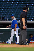 AZL Cubs 1 manager Carmelo Martinez exchanges words with home plate umpire Austin Nelson as he walks to the dugout during an Arizona League game against the AZL Royals on June 30, 2019 at Sloan Park in Mesa, Arizona. AZL Royals defeated the AZL Cubs 1 9-5. (Zachary Lucy/Four Seam Images)