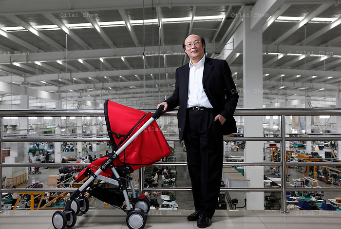 Song Zhenghuan, chief executive officer and chairman of Goodbaby Child Products Company, poses for photographs at the company's stroller assembly line in Kunshan, Jiangsu Province, China, on Monday, May 04, 2009. Once a middle school teacher, Mr. Song is now a self-made billionaire industrialist, his company is China's largest manufacturer and supplier of infants' and children's products.