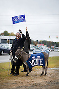 Durham, N.C., residents Jim Paden, as Democratic presidential candidate Barack Obama, and Denny Powel with his donkey, Pipe Cleaner, encourage voters along U.S. 15-501 during early morning traffic Tuesday, Nov. 4, 2008.