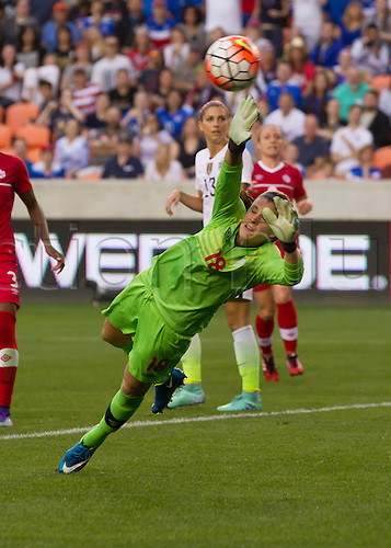 21.02.2016. Houston, TX, USA.  Canada Goalkeeper Stephanie Labbe (18)  attempts to stop a shot on goal during the Women's Olympic qualifying soccer final match between Canada and USA at BBVA Compass Stadium in Houston, Texas.