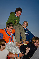 Scouts in Autumn building  a pyramid together.