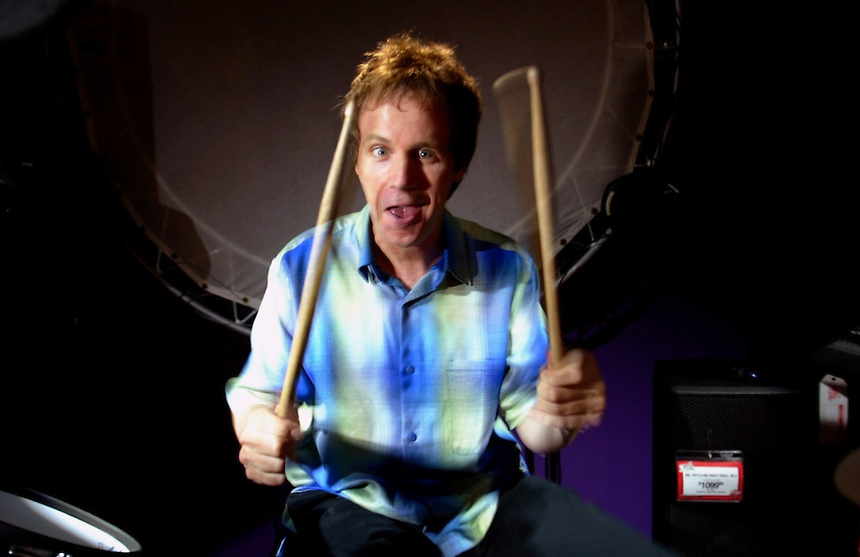 HOLLYWOOD--Guitar Center--Dana Carvey plays drums at the Guitar Center on Sunset in Hollywood.