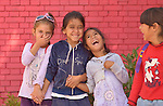 Roma girls laughing in the Nasa Radost preschool in Smederevo, Serbia.