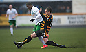 Hib's Franck Dja Djedje is challenged by Alloa's Jason Marr.