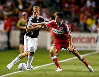 Chicago Fire midfielder Marco Pappa (16) attempts to prevent Chivas USA forward Keith Savage (22) from reaching the ball.  The Chicago Fire defeated Chivas USA 1-0 at Toyota Park in Bridgeview, IL on August 2, 2008.