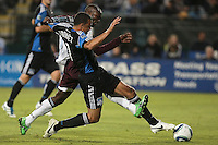 San Jose Earthquakes defender Jason Hernandez (21) battles against Colorado Rapids forward Omar Cummings (14) on the play during the Colorado Rapids 2-1 victory over the San Jose Earthquakes at Buck Shaw Stadium in Santa Clara, California.