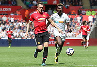 Phil Jones of Manchester United is chased down by Tammy Abraham of Swansea City during the Premier League match between Swansea City and Manchester United at The Liberty Stadium, Swansea, Wales, UK. Saturday 18 August 2017