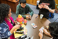 Karonika Brown, 34, (left) plays UNO before a Lunar New Year celebration in the Asian American Connections Center at Middlesex Community College in Lowell, Mass., USA, on Thurs., Feb. 15, 2018. Brown graduated with a degree with an Associates Degree in Liberal Arts and Sciences from Middlesex Community College in 2016, and continues to take classes there and work as a writing tutor for other students. Brown is an immigrant from Cambodia. The Asian American Connections Center was established at the school using a federal grant in 2016 and serves as a focal point for the Asian community at the school, predominantly Cambodian, to gather, socialize, study, and otherwise take part in student life.