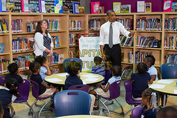 United States President Barack Obama visits a class at Moravia Park Elementary School in Baltimore, Maryland on Friday, May 17, 2013..half length meeting kids children .CAP/ADM/CNP/KT.©Kristoffer Tripplaar/CNP/AdMedia/Capital Pictures