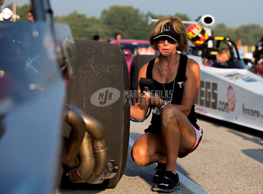 Aug. 30, 2013; Clermont, IN, USA: Kay Torrence wife of NHRA super comp driver Billy Torrence during qualifying for the US Nationals at Lucas Oil Raceway. Mandatory Credit: Mark J. Rebilas-