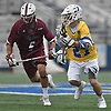 Brendan Kavanagh #27 of Hofstra University, right, gets pressured by Dylan Gruder #5 of UMass, a 2013 graduate of Smithtown West, during the third quarter of an NCAA Division I men's lacrosse game at Shuart Stadium in Hempstead on Saturday, April 22, 2017. Kavanagh scored three goals in Hofstra's 15-8 win.