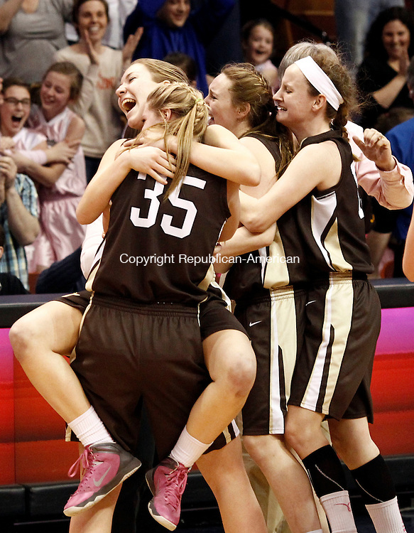 Thomaston's Morgan Sanson and Casey Carangelo (35)  celebrate their win over St. Paul in the Class S State championship game at the Mohegan Sun Arena in Uncasville on Saturday.  Thomaston won, 61-57.   Christopher Massa Republican-American