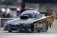 Sept. 14, 2012; Concord, NC, USA: NHRA funny car driver Alexis DeJoria during qualifying for the O'Reilly Auto Parts Nationals at zMax Dragway. Mandatory Credit: Mark J. Rebilas-