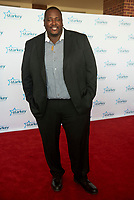 "ST. PAUL, MN JULY 16:  Quinton Aaron poses on the red carpet at the Starkey Hearing Foundation ""So The World May Hear Awards Gala"" on July 16, 2017 in St. Paul, Minnesota. Credit: Tony Nelson/Mediapunch"