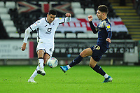 Ben Cabango of Swansea City under pressure from Patrick Schmidt of Barnsley during the Sky Bet Championship match between Swansea City and Barnsley at the Liberty Stadium in Swansea, Wales, UK. Sunday 29 December 2019