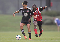BOYDS, MARYLAND - July 21, 2012:  Lianne Sanderson (10) of DC United Women shields the ball from Samantha Hare (22) of the Virginia Beach Piranhas during a W League Eastern Conference Championship semi final match at Maryland Soccerplex, in Boyds, Maryland on July 21. DC United Women won 3-0.