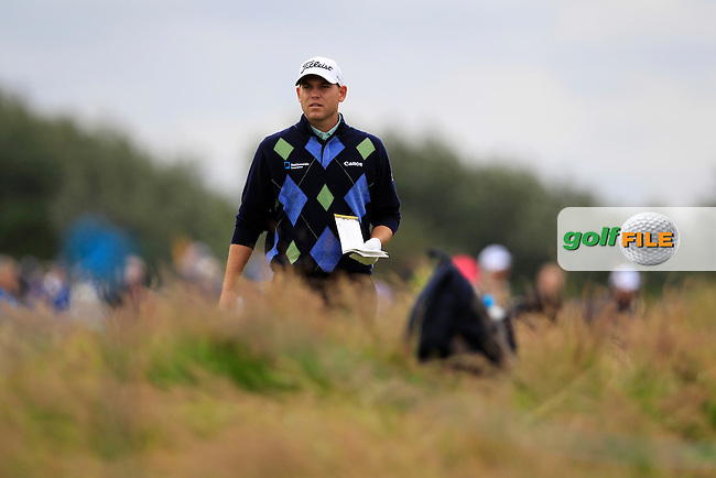 Bill Haas (USA) prepares to play his 2nd shot from the rough on the 14th hole during Thursday's Round 1 of the 141st Open Championship at Royal Lytham & St.Annes, England 19th July 2012 (Photo Eoin Clarke/www.golffile.ie)