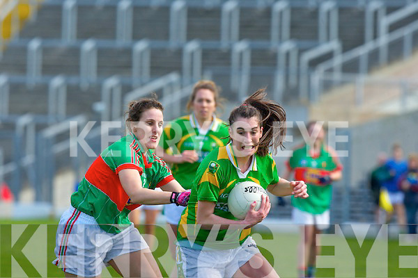 Kerry's impressive midfielder Emma Sherwood shows great determination to go past Mayo's Martha Carter in the Fitzgerald Stadium on Sunday