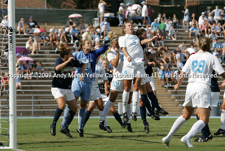 30 August 2009: North Carolina's Ashlyn Harris (18) jumps to punch the ball in traffic. The University of North Carolina Tar Heels defeated the University of North Carolina Greensboro Spartans 1-0 at Fetzer Field in Chapel Hill, North Carolina in an NCAA Division I Women's college soccer game.
