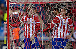 Atletico Madrid's Uruguayan defender Diego Godin (L) celebrates after scoring during the Spanish Copa del Rey (King's Cup) football match Atletico de Madrid vs Athletic de Bilbao at the Vicente Calderon stadium in Madrid on January 23, 2014.   PHOTOCALL3000/ DP