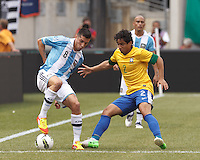 Argentina midfielder Jose Sosa (8) dribbles as Brazil defender Rafael Silva (2) pressures. In an international friendly (Clash of Titans), Argentina defeated Brazil, 4-3, at MetLife Stadium on June 9, 2012.