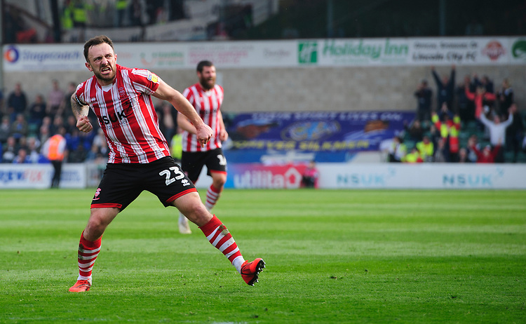Lincoln City's Neal Eardley celebrates scoring his side's equalising goal to make the score 1-1<br /> <br /> Photographer Chris Vaughan/CameraSport<br /> <br /> The EFL Sky Bet League Two - Lincoln City v Macclesfield Town - Saturday 30th March 2019 - Sincil Bank - Lincoln<br /> <br /> World Copyright © 2019 CameraSport. All rights reserved. 43 Linden Ave. Countesthorpe. Leicester. England. LE8 5PG - Tel: +44 (0) 116 277 4147 - admin@camerasport.com - www.camerasport.com