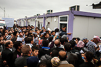 New arrivals crowd around the registration centre in Domiz refugee camp in Northern Iraq. 81,000 Kurds from Syria have fled the civil war in their home country and taken refuge in northern Iraq.