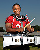 Aaron Dawson of Clarke High School poses for a portrait on the school's football field on Friday, September 18, 2015. The senior excels as both a running back on the gridiron and as a drummer on the school's marching band.<br /> <br /> James Escher