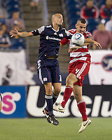 New England Revolution forward Rajko Lekic (10) and FC Dallas defender Andrew Jacobson (4) battle for head ball. In a Major League Soccer (MLS) match, the New England Revolution defeated FC Dallas, 2-0, at Gillette Stadium on September 10, 2011.