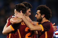 Calcio, Serie A: Roma vs Sampdoria. Roma, stadio Olimpico, 7 febbraio 2016.<br /> Roma&rsquo;s Diego Perotti, left, celebrates with teammates Stephan El Shaarawy, center, and Mohamed Salah, after scoring during the Italian Serie A football match between Roma and Sampdoria at Rome's Olympic stadium, 7 January 2016.<br /> UPDATE IMAGES PRESS/Riccardo De Luca